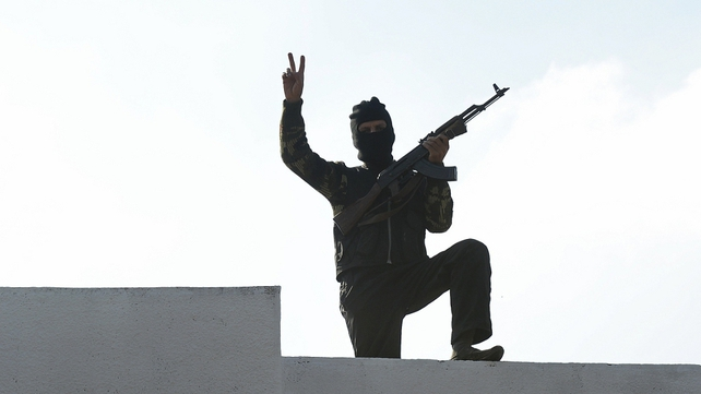 Syrian rebels have taken over military installations in the north and centre of the country
