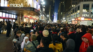 Crowds gather outside Macy's in New York ahead of the midnight opening to start the stores' 'Black Friday' shopping weekend