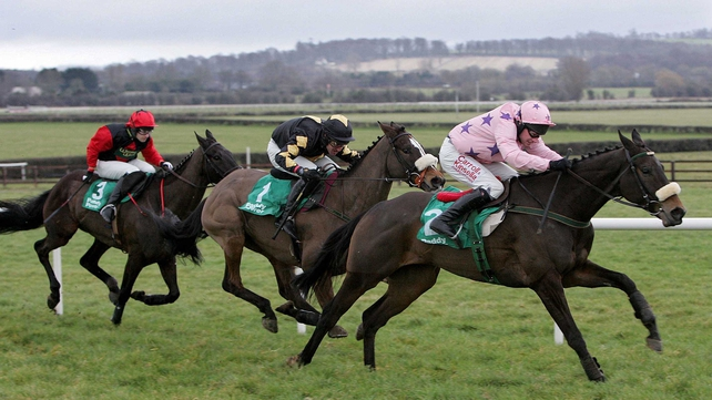 Go Native (R) and Paul Carberry on the way to winning the Johnstown Novice Hurdle in 2009