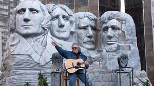 Singer Don McLean makes his way through Columbus Circle during the same parade