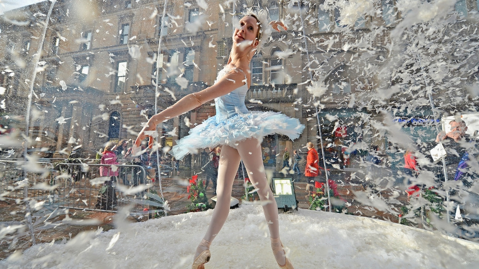 Claire Robertson from Scottish Ballet poses dressed as the Good Snow Flake inside a life size snow globe on Buchanan Street in Glasgow during a promotion for a festive production of 'The Nutcracker'