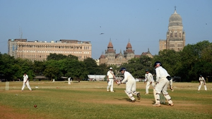 Children play cricket on the Azad Maidan in Mumbai, India