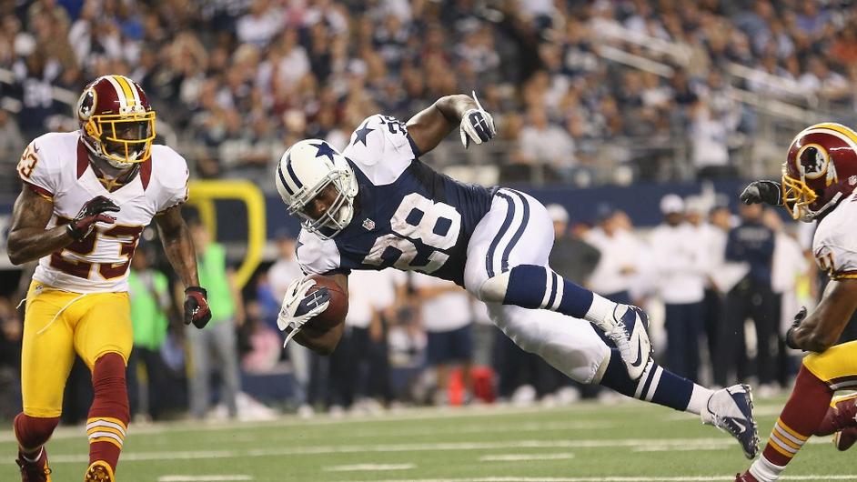 Felix Jones of the Dallas Cowboys runs for a touchdown against the Washington Redskins during a Thanksgiving Day game at Cowboys Stadium in Arlington, Texas