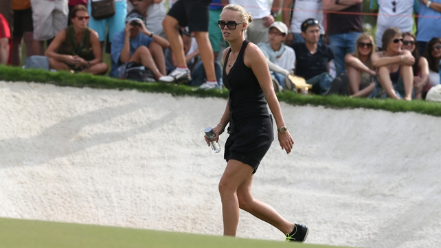 Caroline Wozniacki was again supporting boyfriend Rory McIlroy around the course