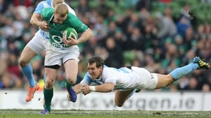Keith Earls evades one would-be tackler