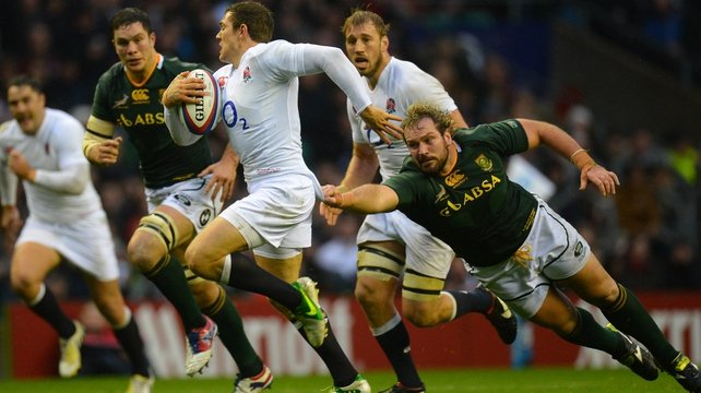 Alex Goode of England breaks away from South Africa's Jannie du Plessis