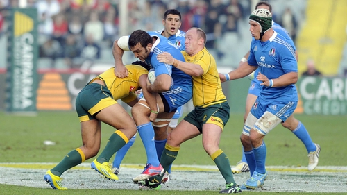 Italy's Quintin Geldenhuys is contained by Australia