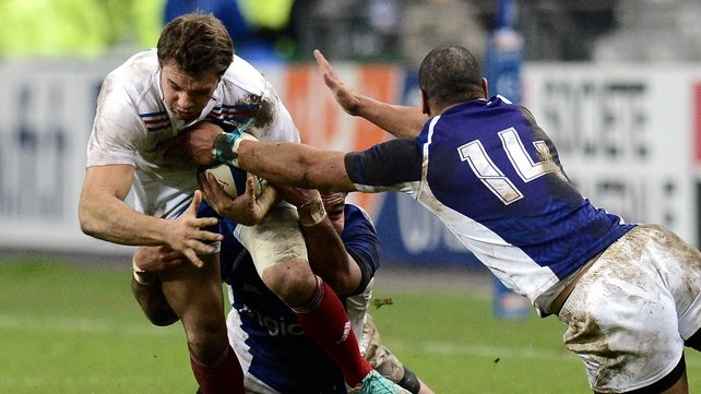 France winger Vincent Clerc is tackled by Samoa's Paul Perez