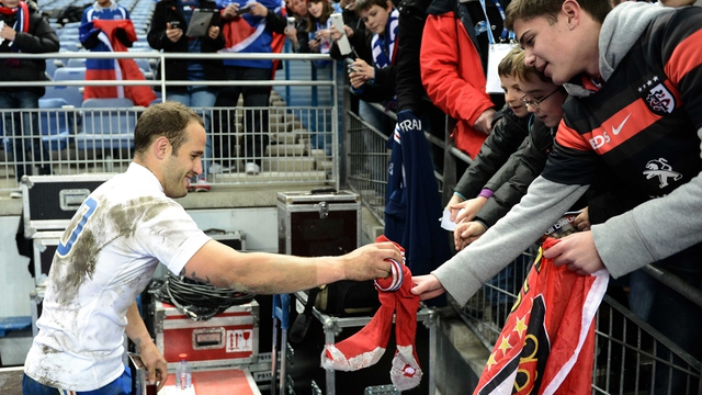 Frederic Michalak gives his socks to supporters