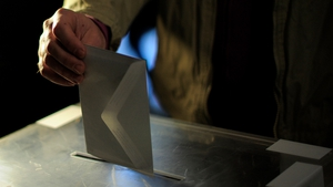 A man casts his ballot for regional elections in Barcelona