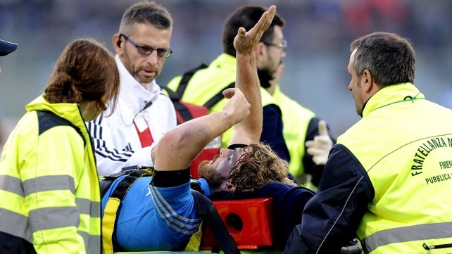 Mirco Bergamasco of Italy is stretchered off at Artemio Franchi