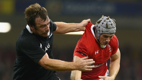 Jonathan Davies spills the ball under the challenge of Andrew Hore