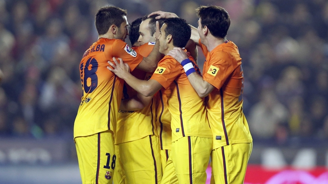 Andres Iniesta is mobbed by his Barca team-mates after scoring at the Ciutat de Valencia Stadium