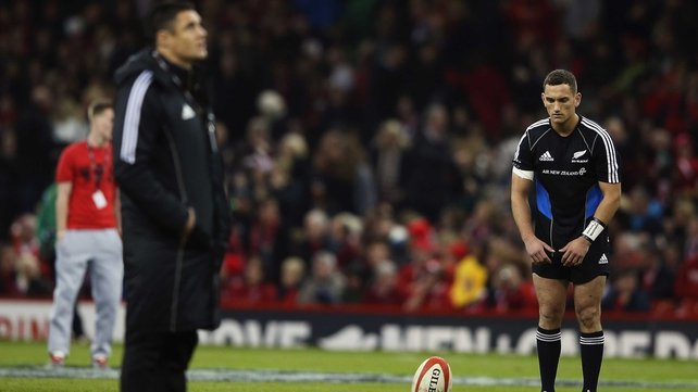 Injured Daniel Carter looks on as Aaron Cruden warms up before the match at the Millennium Stadium