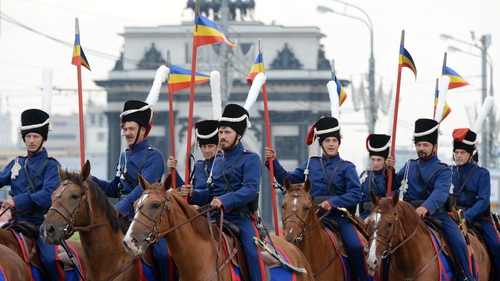 Russian cossacks, wearing historic outfits, ride horses during a march in Moscow in August