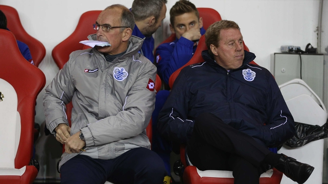QPR manager Harry Redknapp (r) sits next to his assistant manager Joe Jordan
