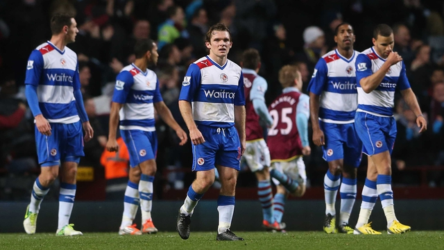 Jay Tabb of Reading and his team-mates look dejected after conceding to Villa