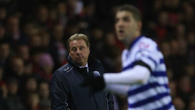 QPR manager Harry Redknapp keeps a close eye on his players