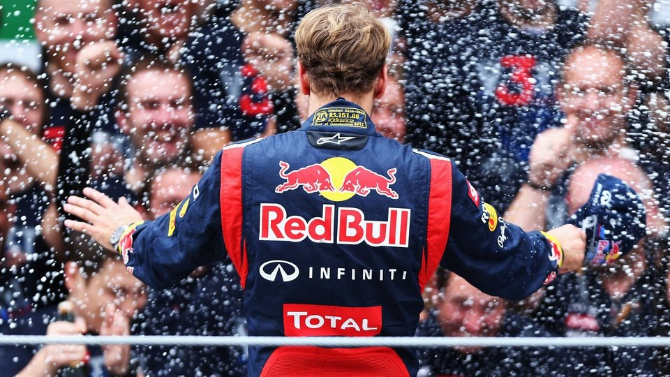 Sebastian Vettel of Germany and Red Bull Racing celebrates his third consecutive Formula 1 World Drivers' Championship title