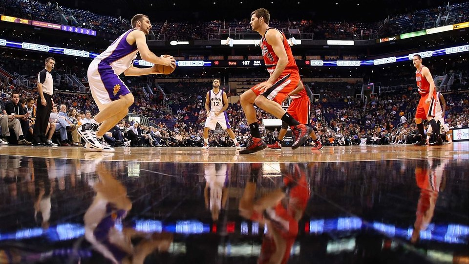 Luke Zeller of the Phoenix Suns looks to shoot guarded by Elliot Williams of the Portland Trail Blazers during the NBA game at US Airways Center