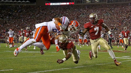 Trey Burton of the Florida Gators is forced out of bounds by Terrence Brooks of the Florida State Seminoles during a game at Doak Campbell Stadium