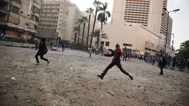 Protesters face Egyptian riot police during clashes on Omar Makram Street, off Tahrir Square, in Cairo