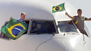 Luis Felipe Scolari (L) and team captain Cafu arriving home following the 2002 World Cup victory
