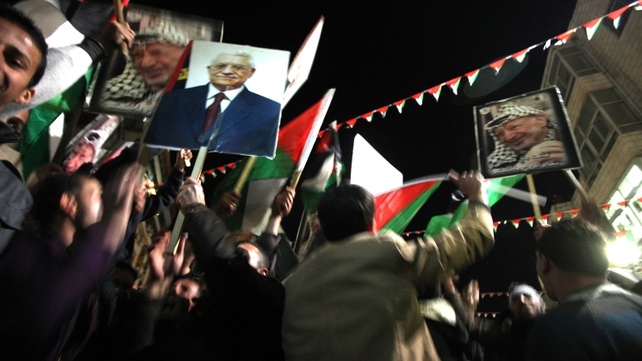 Crowds of Palestinians celebrate on the streets