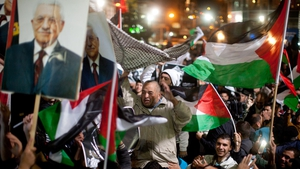 Palestinians celebrate on the streets in Ramallah after the UN General Assembly voted to upgrade the Palestinian Authority's status to non-member observer state