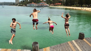 People dive off Manly Wharf in Sydney, Australia. Temperatures in the high 30s and low 40s are expected to hit parts of New South Wales over the weekend