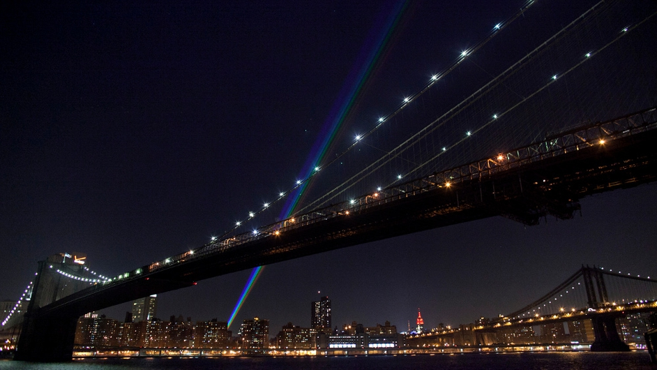 A rainbow of laser lights marking one month since Hurricane Sandy is seen from Brooklyn in New York City