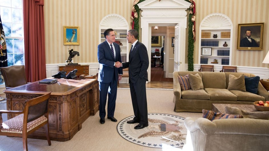 Former Republican presidential candidate Mitt Romney shakes hands with US President Barack Obama in the Oval Office in the White House