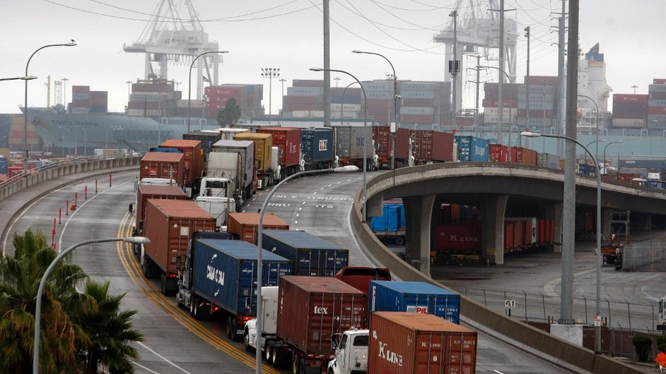 Shipping container trucks sit in traffic as an International Longshore and Warehouse Union strikes puts a halt to most of the work at the busiest seaport complex in the US in Long Beach, California