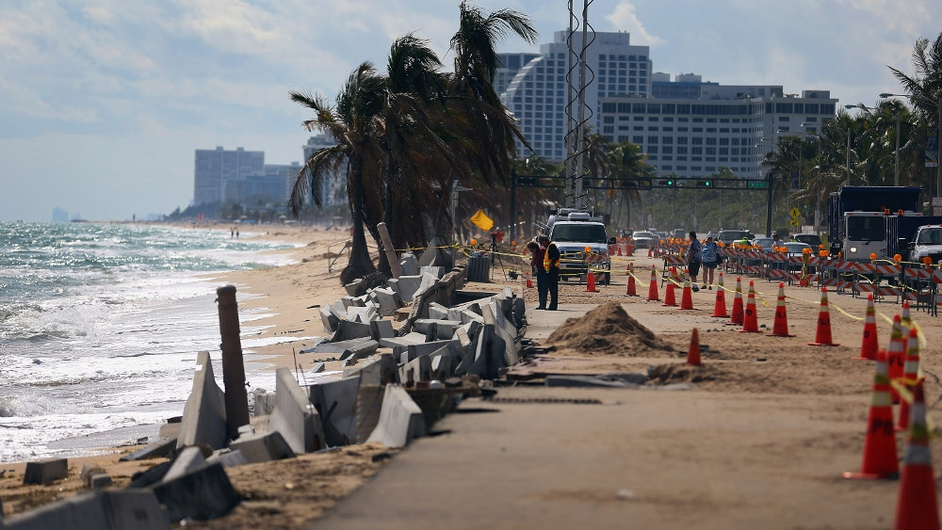 Cones mark off the damage caused by beach erosion along route A-1-A, making parts of it impassable to vehicles on in Fort Lauderdale, Florida