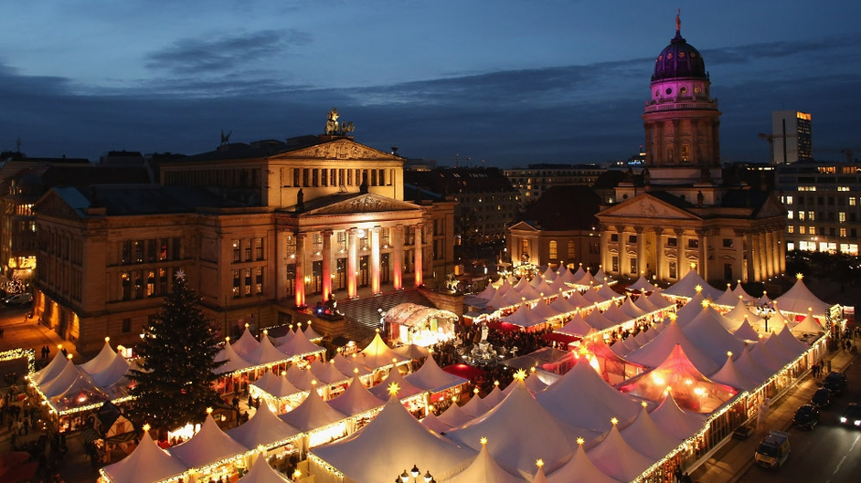 The annual Christmas market at Gendarmenmarkt stands illuminated in the city centre on its opening day on in Berlin, Germany