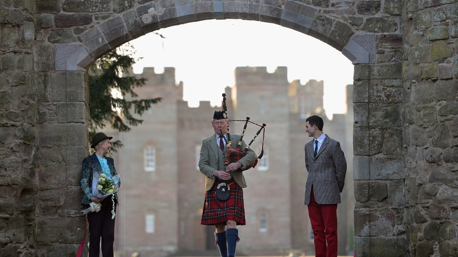 A piper performs as the restored historic archway is opened at Scone Palace in Perth, Scotland