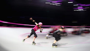 Skaters compete during the Roller Derby Extreme between the LA Derby Dolls and the New York Gotham Girls at Hisense Arena