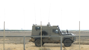 An Israeli military vehicle patrols the border