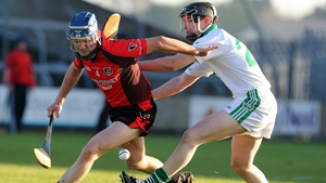 Oulart's Barry Kehoe battles with Patrick Reid for posession
