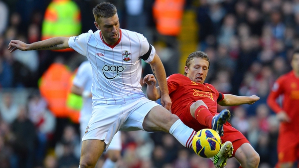 Lucas Leiva (R) returned to the Liverpool starting line-up following injury