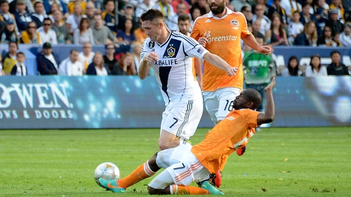 Robbie Keane takes on Dynamo's Colin Clark