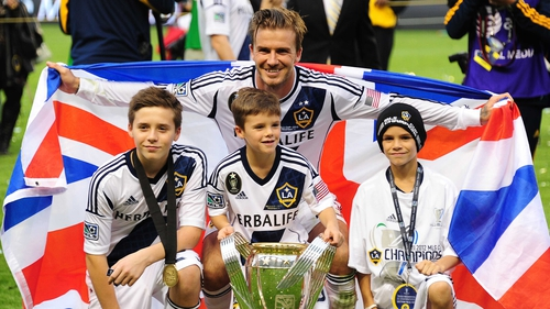 David Beckham celebrates with his three sons following LA Galaxy's MLS Cup win