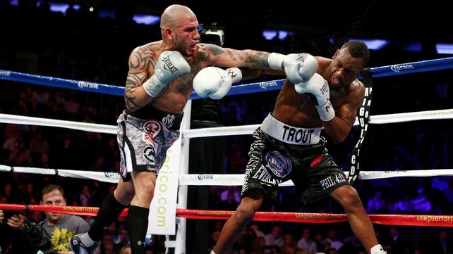 Austin Trout continued his unbeaten record by beating Miguel Cotto