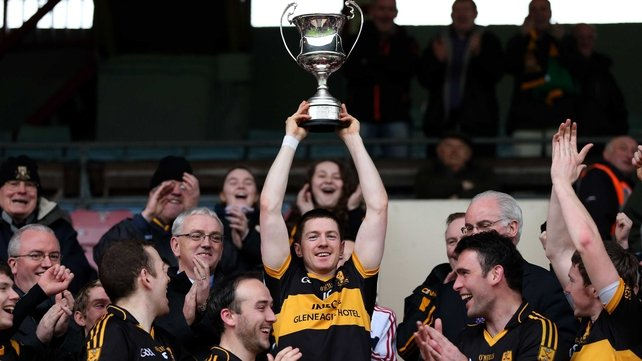Kieran O'Leary lifts the trophy for the Munster champions