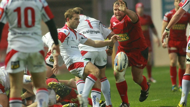 Ulster's Paul Marshall clears under pressure