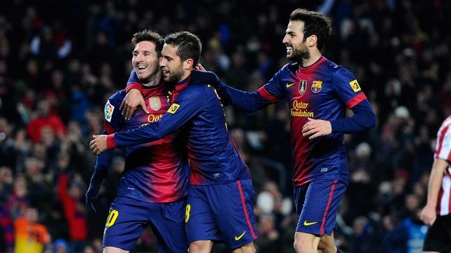 (L-R) Lionel Messi, Jordi Alba and Cesc Fabregas celebrate at the Nou Camp