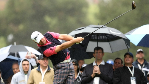Graeme McDowell hits his tee shot on the second hole earlier today