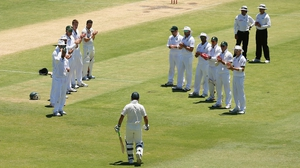 Ricky Ponting of Australia is given a guard of honour by South Africa on the occasion of his last innings at Test level, he was out was for eight runs