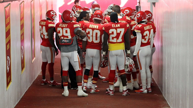 A sombre Kansas City Chiefs side huddle in prayer in the tunnel prior to their game with Carolina Panthers