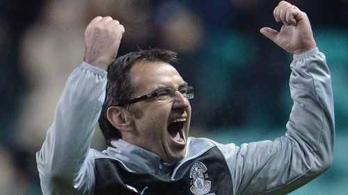 Pat Fenlon celebrates victory over Hearts yesterday